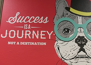 Success is a story sign with animated dog
