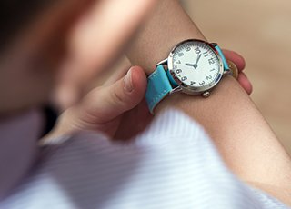 Person checking watch