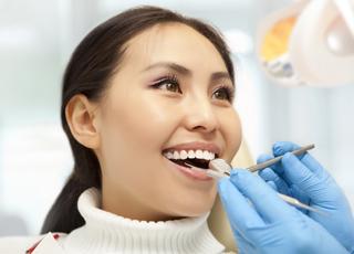 Woman receiving dental exam