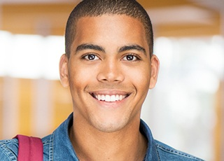 Young man with straight healthy smile