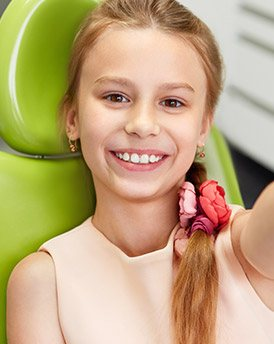 Preteen girl in dental chair