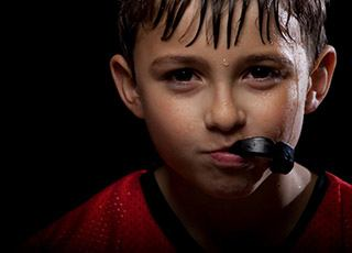 Boy with sportsguard in mouth